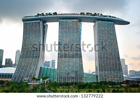 SINGAPORE - MARCH 06: Marina Bay Sands Resort at sunset on March 06, 2013 in Singapore. It is billed as the world's most expensive standalone casino property at S$8 billion