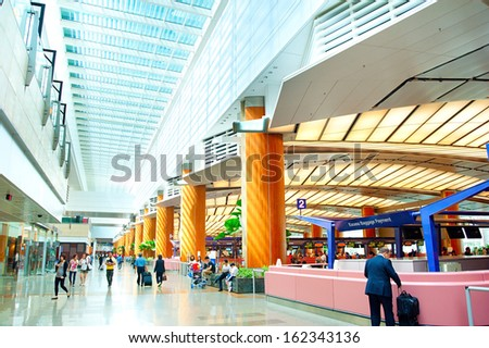 SINGAPORE - MARCH 05 : Modern interior of  Changi International Airport on March 05, 2013 in Singapore. Changi Airport serves more than 100 airlines operating 6,100 weekly flights  - stock photo