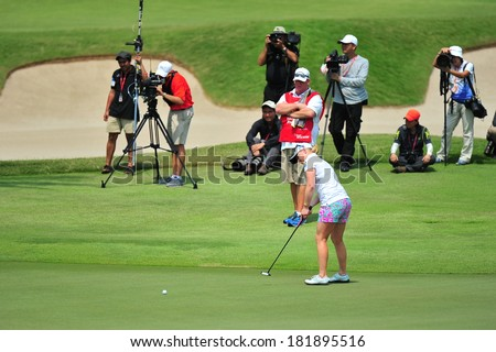 SINGAPORE - MARCH 2: Morgan Pressel putting at hole 18 green during HSBC Women's Champions at Sentosa Golf Club Serapong Course March 2, 2014 in Singapore