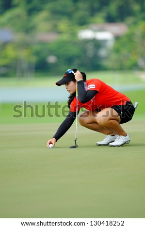 SINGAPORE - MARCH 2: Moriya Jutanugam from Thailand placing her golf ball during HSBC Women's Champions at Sentosa Golf Club Serapong Course March 2, 2013 in Singapore
