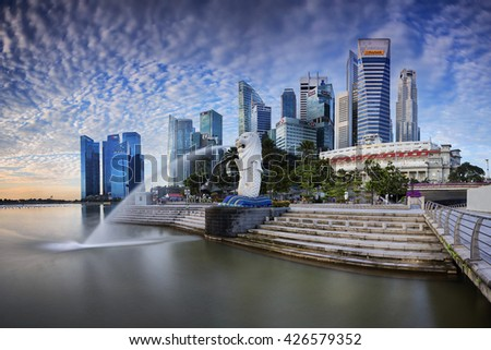 Singapore - 14 March 2015 - Morning Light shine on Merlion and Raffles Place, Raffles City, Central Business District in Singapore - stock photo