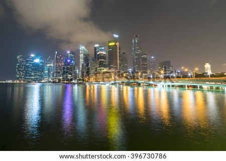 Singapore - March, 2016: Night scene at Marina Bay city skyline. Marina Bay is a famous tourist attraction and shopping destination in Singapore.
