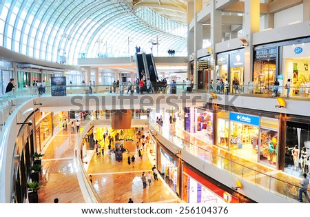 SINGAPORE - MARCH 08, 2013: Shopping mall at Marina Bay Sands Resort in Singapore. It is billed as the world's most expensive standalone casino property at S$8 billion  - stock photo