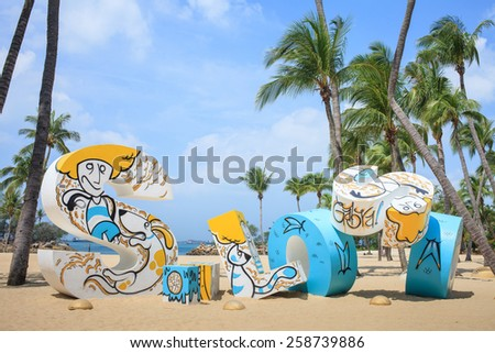 SINGAPORE - MARCH 26:Siloso Beach Statue Landmark of Sentosa Island, Singapore, MARCH 26, 2014, Sentosa island, Singapore. Siloso is landmark that people will came to take photo at this statue. - stock photo
