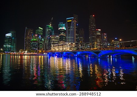 SINGAPORE - MARCH 3: Singapore downtown cityscape on March 3, 2012 in Singapore. Singapore downtown with business area, hotels and casinos is main tourist attraction of the city. - stock photo