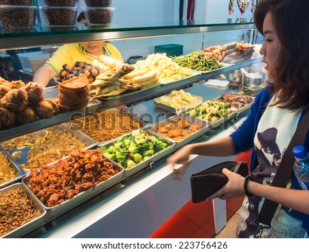 SINGAPORE - MARCH 09: Street foods in Singapore. Inexpensive food stalls are numerous in the city so most Singaporeans dine out at least once a day. Singapore, March 09,2014 - stock photo