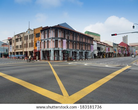SINGAPORE - March 08: Street scene in Singapore's Chinatown on March 08, 2014 in Singapore. The city state's ethnic Chinese began settling in Chinatown circa 1820s. - stock photo