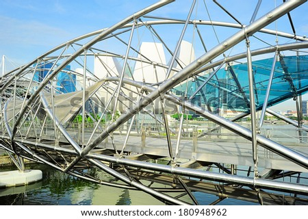 SINGAPORE - MARCH 08, 2013: The Helix Bridge in Singapore. Is a bridge in the Marina Bay. The Helix is fabricated from 650 tonnes of Duplex Stainless Steel and 1000 tonnes of carbon steel. - stock photo