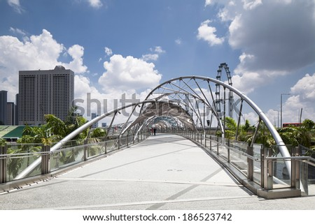 SINGAPORE - MARCH 27 : The Helix Bridge on March 27, 2014 in Singapore. The Helix  Bridge is fabricated from 650 tons of Duplex Stainless Steel and 1000 tons of carbon steel. - stock photo