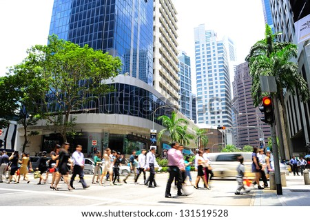 SINGAPORE - MARCH 07: Unidentified businessmen crossing the street on March 7, 2013 in Singapore. There are more than 7,000 multinational corporations from US States, Japan and Europe in Singapore