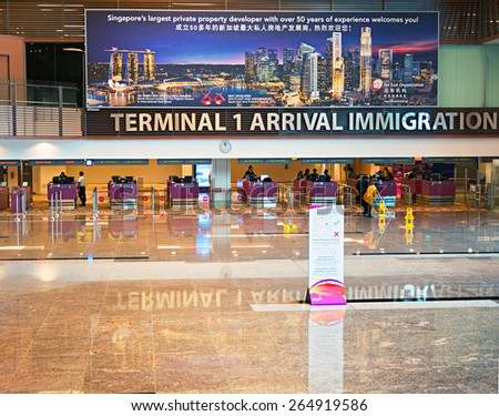 SINGAPORE - MARCH 03, 2013: View of immigration control at Changi International Airport in Singapore. Changi is the main aviation hub in SE Asia, handling 66 million passengers annually. - stock photo