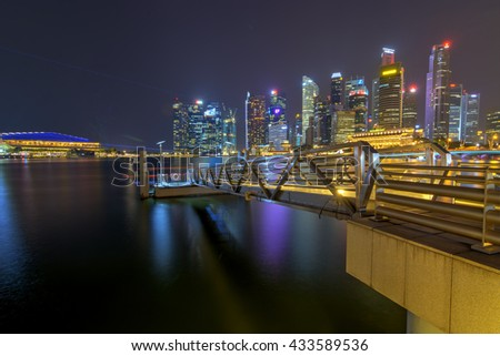 SINGAPORE - MARCH 18: View of skyscrapers in Marina Bay on March 18, 2016 in Singapore. Singapore is the world's fourth leading financial centre. - stock photo