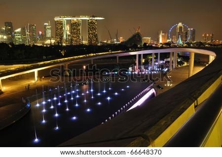 Singapore Marina Barrage against skyline at night - stock photo
