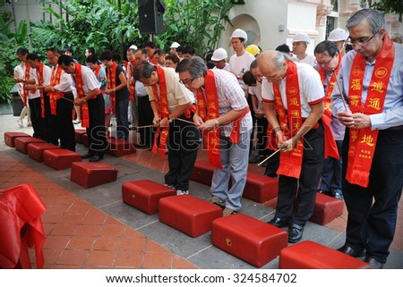 SINGAPORE - MAY 10: Devotees take part in a ceremony at a Taoist shrine on May 10, 2013 in Singapore. The SE Asian city state has a significant Taoist following in its ethnic Chinese communities. - stock photo