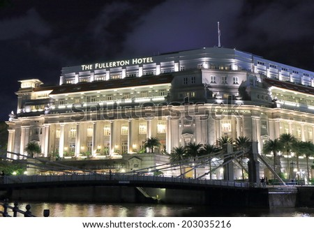 SINGAPORE - 27 May, 2014:Fullerton Hotel by night. Fullerton Hotel is a five star luxury hotel located near the mount of the Singapore river in the downtown area.  - stock photo