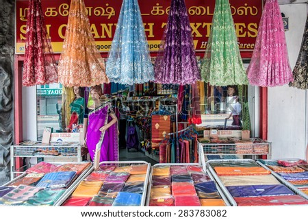 SINGAPORE, MAY 8: Indian colorful fabric and clothes shop in Little India, on May 8, 2015 in Singapore - stock photo