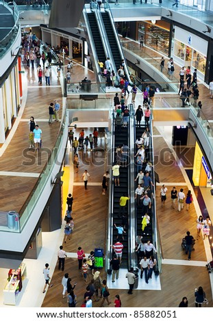 SINGAPORE - MAY 02: Shopping centre at Marina Bay Sands Resort on May 02, 2011 in Singapore. It is billed as the world's most expensive standalone casino property at S$8 billion - stock photo