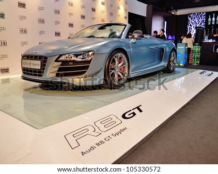 SINGAPORE - MAY 18: Side profile of Audi R8 GT Spyder on display at Audi Fashion Festival 2012 on May 18, 2012 in Singapore - stock photo