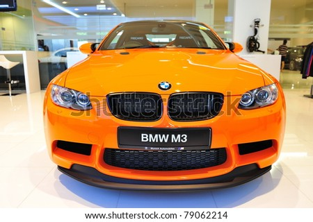 SINGAPORE - MAY 21: Static display of BMW M3 GTS sports coupe at Munich Automobiles BMW Service Centre Open House on May 21, 2011 in Singapore - stock photo