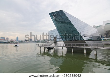 SINGAPORE - MAY 15, The futuristic building of Louis Vuitton extends out into Marina Bay on May 15, 2015 in Singapore - stock photo