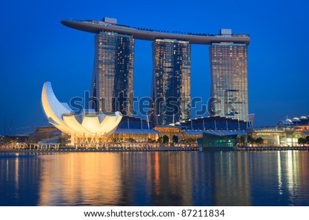 SINGAPORE - MAY 6: The Marina Bay Sands complex on sunset on May 6, 2011 in Singapore. Marina Bay Sands is an integrated resort and billed as the world's most expensive standalone casino property - stock photo