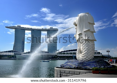 SINGAPORE-MAY 9 : The Merlion and the Marina Bay Sands Resort Hotel, billed as the worlds most expensive standalone casino property at S$8 billion on May 9, 2012 in Singapore.  - stock photo