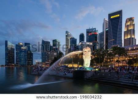 SINGAPORE-May 25 : The Merlion fountain and Singapore skyline on May 25, 2014. Merlion is an imaginary creature with a head of a lion and the body of a fish and is often seen as a symbol of Singapore. - stock photo