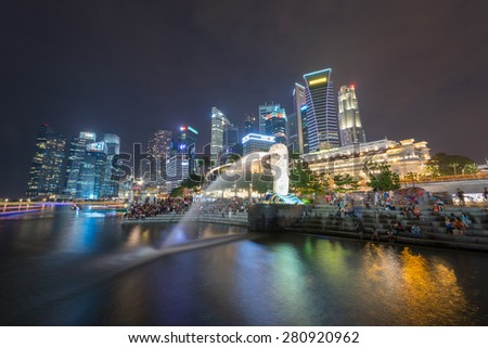 SINGAPORE-MAY 23:The Merlion fountain May 23, 2015 in Singapore.Merlion is a mythical creature with the head of a lion and the body of a fish,and is a symbol of Singapore. - stock photo