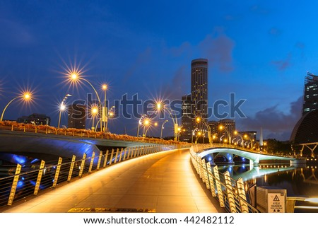 SINGAPORE - 20 May 2016: This Bridge for Tourists strolling  the newly constructed Jubilee Bridge, built for pedestrians alongside the older Esplanade Theatre Bridge in Singapore. - stock photo
