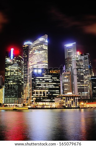 Singapore modern architecture reflecting in the river - stock photo