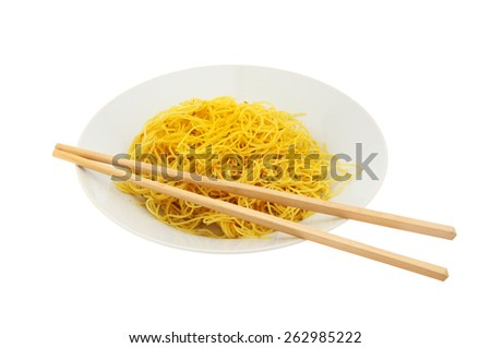 Singapore noodles in a bowl with chopsticks isolated against white - stock photo