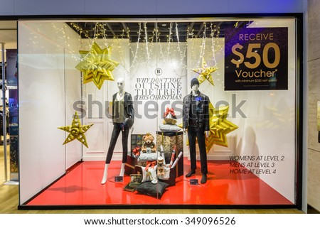 SINGAPORE-NOV 26, 2015: Fashion boutique/outlet windows display with mannequin and Christmas decoration at JEM Robinsons Shopping Mall. It's a retail company which has stores in Singapore and Malaysia - stock photo