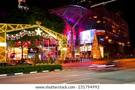 SINGAPORE - NOV 19: Night view of Christmas Decoration at Singapore Orchard Road on November 19, 2014 in Singapore. The street and shopping centres decorated with shiny stars and christmas decorations - stock photo
