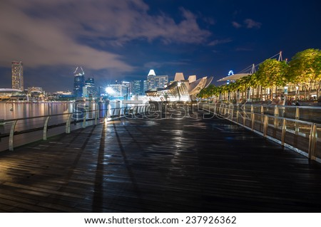 SINGAPORE - NOV 24: Walking bridge in front of Marina Bay Sands hotel, November, 2014.Singapur one of the largest financial centers in the world. - stock photo