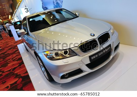 SINGAPORE - NOVEMBER 14: BMW 320i M Sport Sedan at BMW World Singapore 2010 at Marina Bay Sands Expo November 14, 2010 in Singapore - stock photo