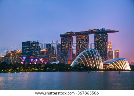 SINGAPORE - NOVEMBER 07: Marina Bay Sands hotel and Gardens by the Bay at night time on November 07, 2015 in Singapore. - stock photo
