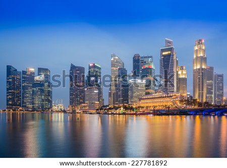 SINGAPORE-NOVEMBER 2: The Singapore skyline in twilight time on November 2,2014. Singapore is the 14th largest exporter and the 15th largest importer in the world