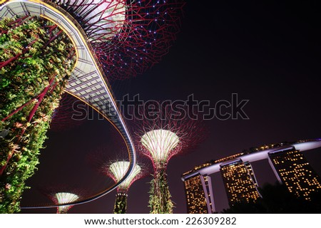 SINGAPORE-OCT 25: Night view of The Supertree Grove at Gardens by the Bay on October 25, 2014 in Singapore. Spanning 101 hectares, and five-minute walk from Bayfront MRT Station. - stock photo