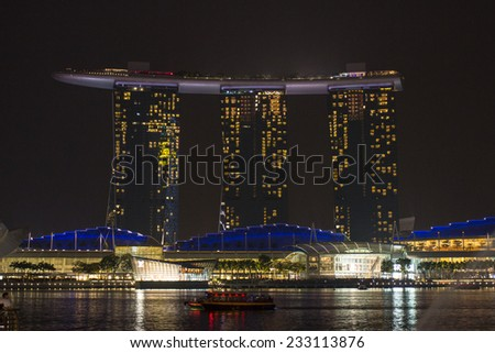 SINGAPORE - OCT 18 : Nightscape of Singapore Marina Bay Sand on Oct 18, 2014, Singapore. Marina Bay Sands is billed as the world's most expensive standalone casino property at S$8 billion. - stock photo