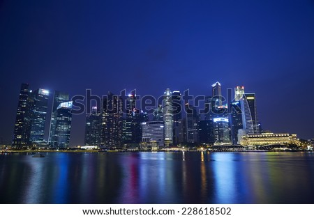 SINGAPORE - OCT 19, 2014 : Scenery of Singapore Marina Bay area, Skyline and modern of business district Marina Bay Sands at most financial developing Asian city state. Singapore, Oct 19, 2014 - stock photo