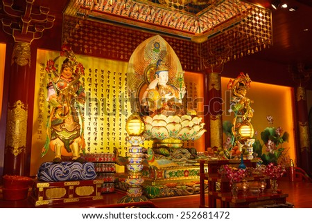 SINGAPORE -OCT 12, 2012: The Maitreya Buddha statue of Buddha Tooth Relic Temple in Chinatown district, Singapore. The temple built to house the tooth relic of the historical Buddha. - stock photo