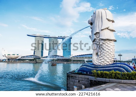 SINGAPORE-OCT 28: The Merlion fountain and Marina Bay Sand on OCT, 28, 2014. Merlion is an imaginary creature with a head of a lion and the body of a fish and  symbol of Singapore.