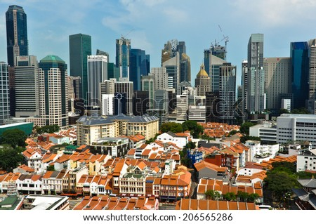 SINGAPORE - OCTOBER 20: Aerial view of Chinatown and Central Business District on October 20, 2012. Singapore is one of East Asia's fastest financially growing city. - stock photo