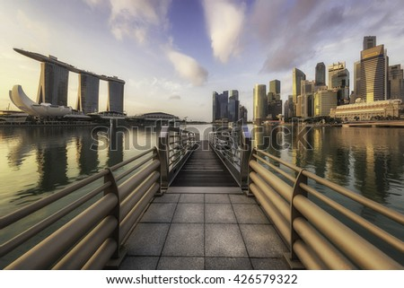 Singapore - 16 October 2015 - Sunrise over Marina Bay Sands and Raffles City, skyline at Singapore - stock photo