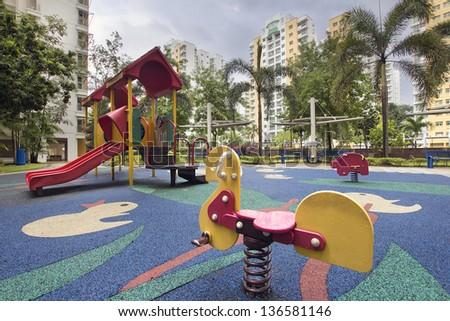 Singapore Public Housing Apartments Animal Ride at Children Playground in Punggol District - stock photo