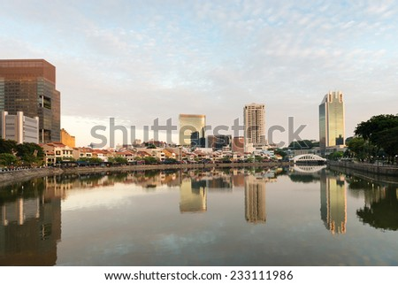 Singapore quay skyline at morning with small restaurants on Boat Quay and sky reflection in Singapore river - stock photo
