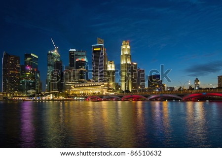 Singapore River Waterfront Skyline at Blue Hour from Esplanade - stock photo