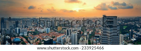 Singapore rooftop view with urban skyscrapers at sunset.   - stock photo