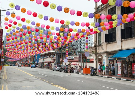 SINGAPORE - SEP 08: Chinatown street is decorated with colorful paper lanterns for Mid-Autumn festival on Sep 08, 2013 in Singapore. It is a traditional Chinese harvest celebration. - stock photo