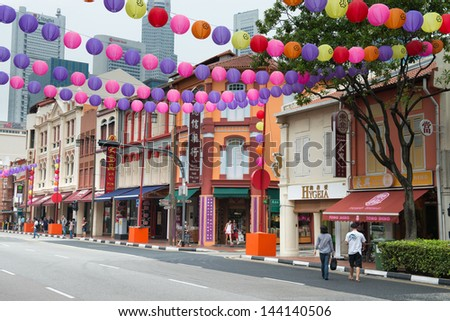 SINGAPORE - SEP 08: Chinatown street is decorated with colourful paper lanterns for Mid-Autumn festival on Sep 08, 2013 in Singapore. It is a traditional Chinese harvest celebration. - stock photo
